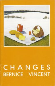 """image of the cover of """"Changes"""" exhibition catalogue showing the painting """"Picnic"""" which depicts a white picnic blanket with picnic basket, apples and dishware. at the bottom of the image, the blanket rests on grass. at the top of the image, the blanket becomes snow that recedes into a winter landcape of hills and bare trees."""